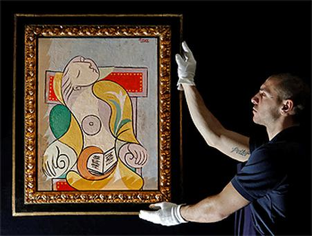 An employee poses with Picasso's