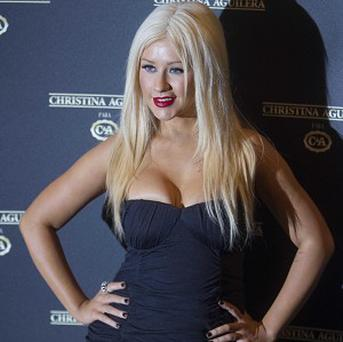 Christina Aguilera fluffed a line as she belted out the national anthem at the start of the US Super Bowl
