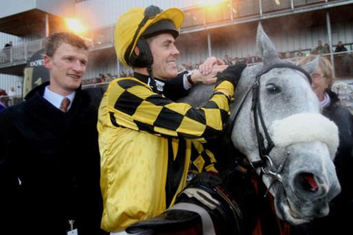 Jockey Andrew McNamara with his mount The Listner and trainer Nick Mitchell (left). Photo: PA