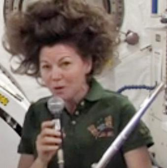 Catherine Coleman and her flute aboard the International Space Station (AP)