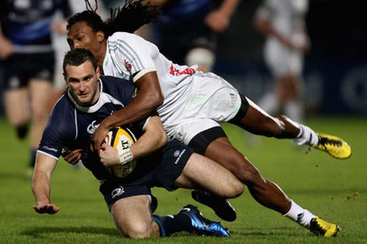 Danwell Demas tackles Dave Kearney. Photo: Getty Images