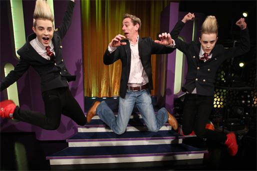 Ryan Tubridy (centre) caught on the hop with Jedward at RTE studios, Dublin