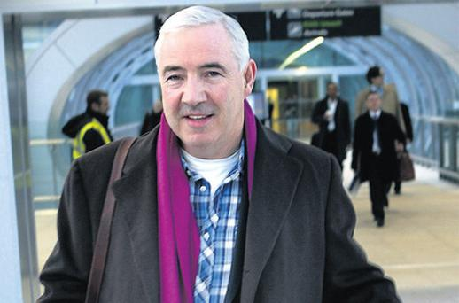 Sean Dunne arriving at Dublin Airport yesterday on a business trip