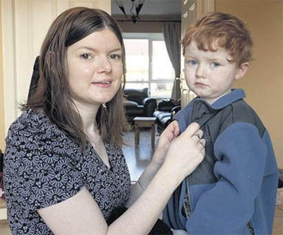 Kathleen Funchion pictured getting ready for the day with her son Emmet, aged three