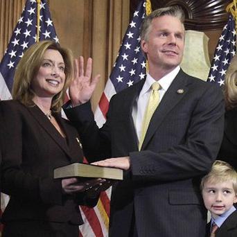 US congressman Chris Lee, picture with his wife Michelle has resigned his seat, saying he regrets his actions (AP)