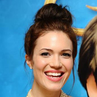 Mandy Moore stars as Rapunzel in Tangled