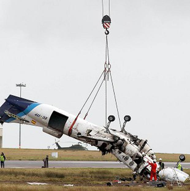 The wreckage of the Manx2 plane in which six people died is removed from the runway at Cork Airport