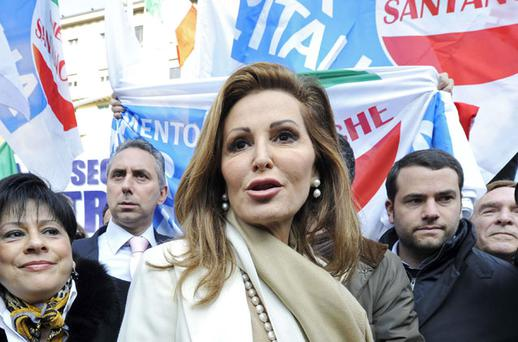 Politician Daniela Santanche (centre) attends a demonstration supporting Italian Prime Minister Silvio Berlusconi at the entrance of Milan's court yesterday. Photo: REUTERS/PAOLO BONA