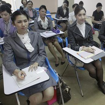 Four Thai 'ladyboys' have been recruited as flight attendants for a start-up charter airline (AP)
