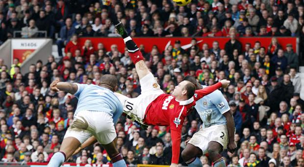 Manchester United's Wayne Rooney scores against Manchester City from an overhead kick. Photo: Reuters
