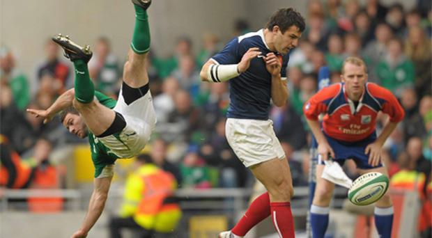 Ireland's Fergus McFadden faces a bumpy landing after colliding with France's Damien Traille