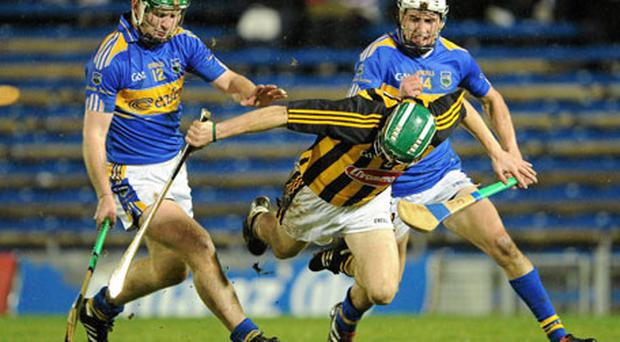 Kilkenny's Tommy Walsh loses his footing as he comes under pressure from Tipperary's Noel McGrath and Patrick Maher during the Allianz Hurling League clash at Semple Stadium. Photo: Brendan Moran / Sportsfile