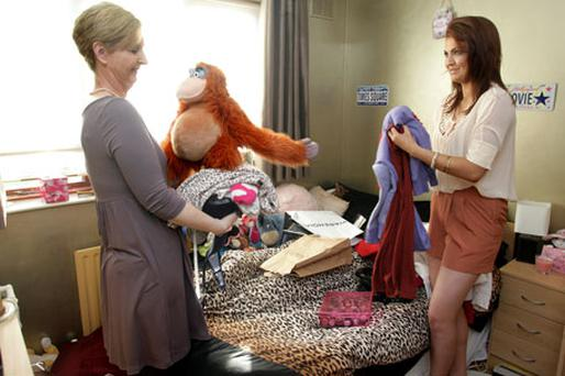 My house, my rules: Ann Long helps her daughter Emma tidy her room at home in Porterstown, Dublin. Photo: Ronan Lang