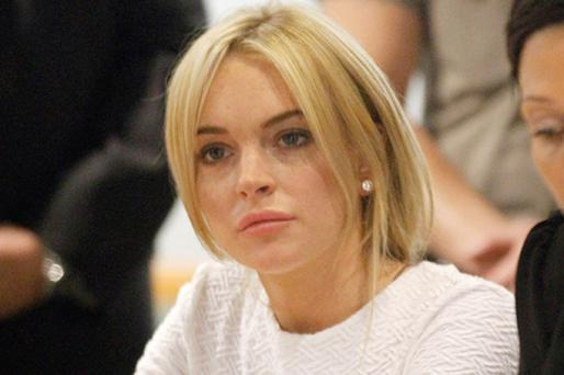 Lindsay Lohan during her arraignment for a felony count of grand theft. Photo: Getty Images