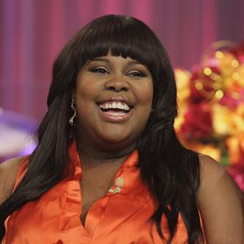 Amber Riley said it feels weird to be nominated for a Grammy