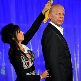 Hollywood hard man Bruce Willis has been unveiled at Madame Tussauds as a Valentine dream date