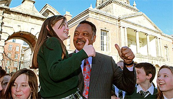 The Reverend Jesse Jackson meets children from Scoil Oilibheir in Blanchardstown at the launch of the Equality and Rights Alliance Roadmap. Photo: PA