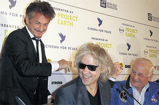 Sean Penn, left, Bob Geldof and astronaut Buzz Aldrin at a press conference during the Berlin Film Festival yesterday