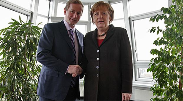 Fine Gael leader Enda Kenny with German Chancellor Angela Merkel yesterday, prior to their meeting in Berlin where Mr Kenny briefed Ms Merkel on Ireland's economic situation