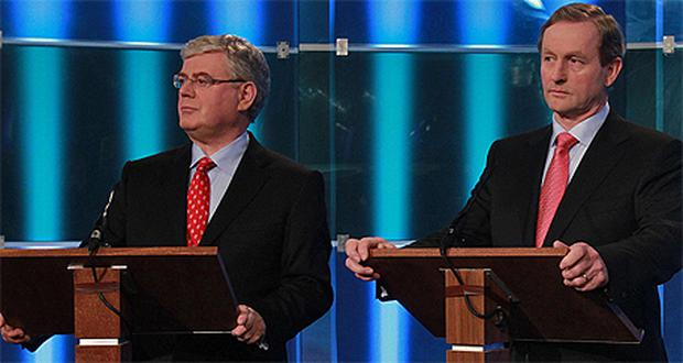 Labour's Eamon Gilmore and Enda Kenny of Fine Gael during last night's leaders' TV debate