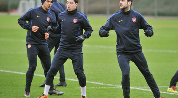 Arsenal's (from left) Theo Walcott, Samir Nasri and Cesc Fabregas during the training session at London Colney. Photo: PA