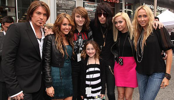 Billy Ray Cyrus (left) and wife Tish (right) with family (left - right) Miley, Braison, Noah Lindsey, Trace and Brandi. Photo: Getty Images