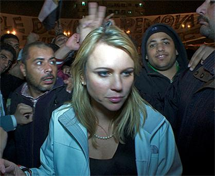 This photo of Lara Logan was taken moments before she was separated from her TV crew, dragged away and attacked. Photo: Reuters