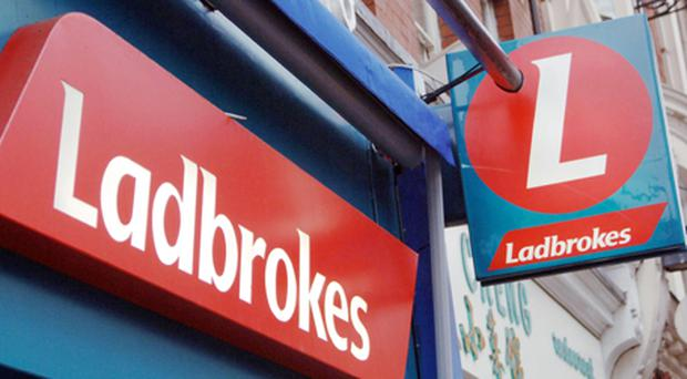 Ladbrokes overcame a 7pc fall in bets staked at its shop counters and reported a 20pc jump in annual profits. Photo: PA