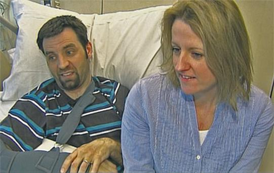 Manx2 plane crash survivor Mark Dickens and his wife Tara in Cork University Hospital yesterday