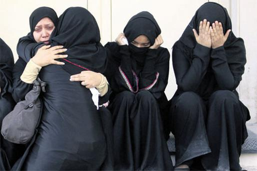 Bahraini women wait outside a hospital in Manama, Bahrain, yesterday, where victims of the confrontation between anti-government protesters and riot police were being treated