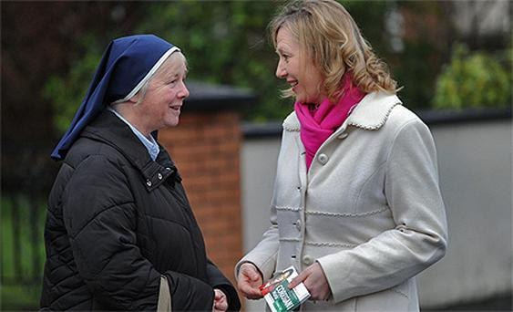 Maria Corrigan, Fianna Fail candidate for Dublin South, speaks to Sister Joan in Stillorgan, Dublin, yesterday