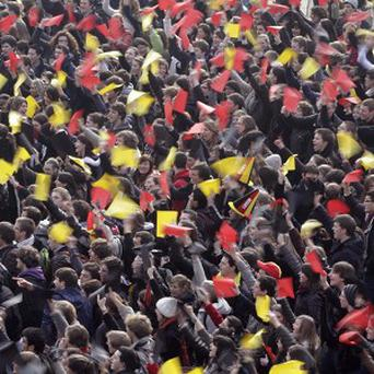 Students wave red, yellow and black paper during a pro-unity demonstration in Louvain-La-Neuve, Belgium (AP)