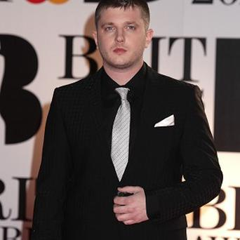 Plan B had dancers dressed as riot police on the Brits stage