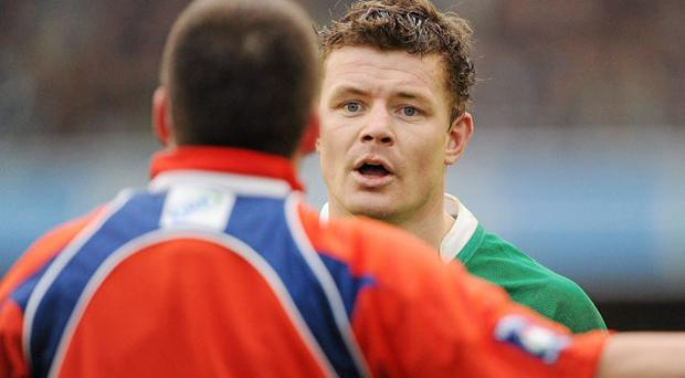 Ireland captain Brian O'Driscoll has words with referee Dave Pearson. Photo: Sportsfile