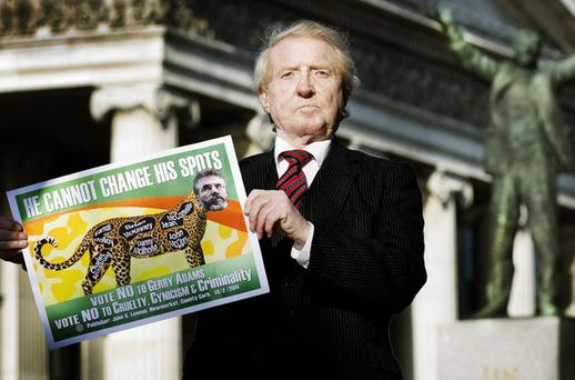SPOT OF BOTHER: John V Lennon campaigns against the SF leader outside the GPO in Dublin yesterday. Photo: David Conachy.