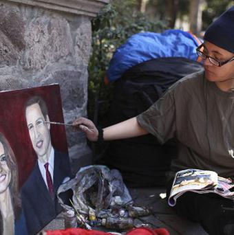 Estibalis Chavez paints a portrait of Prince William and Kate Middleton outside the British Embassy in Mexico City