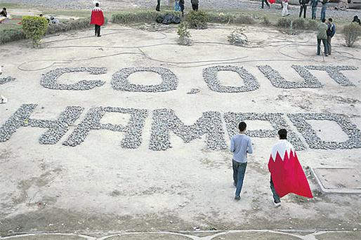 A message written with stones and addressed to the king in Manama, Bahrain, yesterday