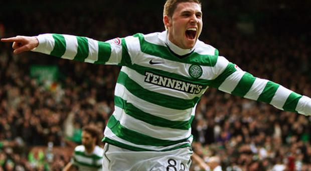 Gary Hooper celebrates opening the scoring at Celtic Park yesterday. Photo: Getty Images