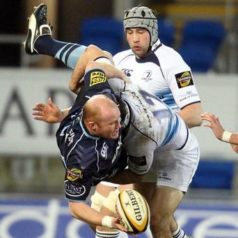 Leinster's Eamonn Sheridan tackles Martyn Williams of Cardiff during their Magners League match in Cardiff on Saturday. Photo: Steve Pope / Sportsfile