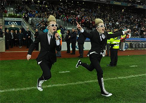 Jedward running on to the Croke Park pitch to entertain the fans in between Saturday's league double-header matches to the delight of many of the youngsters in the crowd. Photo: Sportsfile