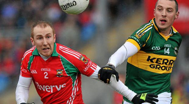 Kerry's Kieran Donaghy grapples with Mayo's Tom Cunniffe during their clash at McHale Park, Castlebar, Kerry beat Mayo 1-9 - 0-8. Photo: Brian Lawless / Sportsfile