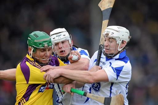 Wexford's Keith Rossiter finds himself outnumbered by Stephen Molumphy and Richie Foley in a hard fought dogged match, however Wexford were beaten by Waterford 1-11 to 0-12. Photo: Matt Browne / Sportsfile