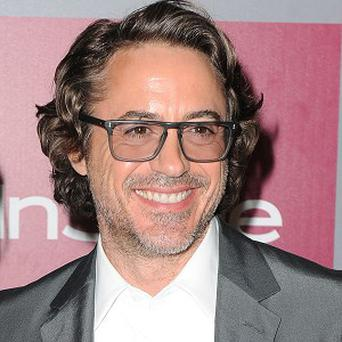 Robert Downey Jr. is reportedly considering a role in Inherent Vice