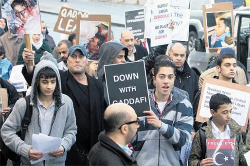 Libyan demonstrators protesting over the regime of Libyan leader Muammar Gaddafi in Dublin yesterday, where they marched to the Department of Foreign Affairs