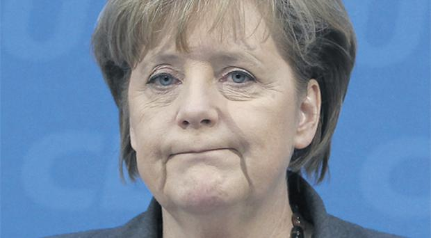 German Chancellor and leader of the conservative Christian Democratic Union party CDU Angela Merkel reacts to the landslide defeat in a state election in Hamburg yesterday
