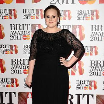 Adele has celebrated a chart double as she held the number one spot in both the singles and album charts