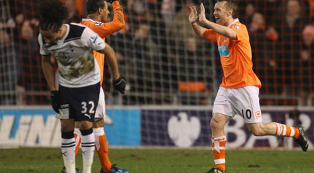 Brett Ormerod celebrates scoring Blackpool's third goal with DJ Campbell. Photo: Getty Images