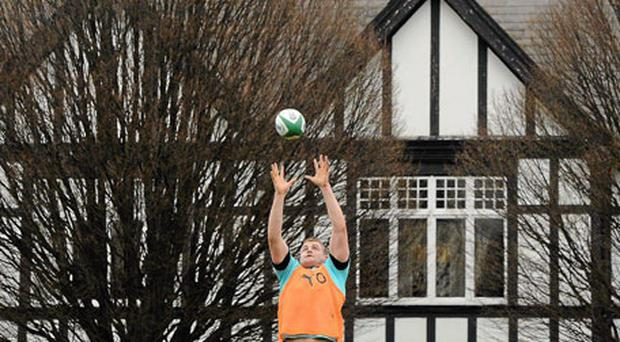 Jamie Heaslip catches a line-out ball during squad training yesterday at the RDS. Ireland's lack of significant height in the backrow has put Declan Kidney's forwards under pressure when the ball thrown to the back of the line.