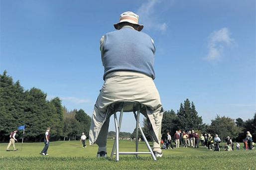 A supporter sits engrossed in the Cups and Shields action . . . but the GUI Blue Riband of club golf needs a new sponsor for 2011 now that Bulmers have ended their 19-year support of the event.