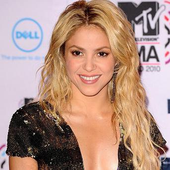 Shakira has been pictured holding hands with footballer Gerard Pique